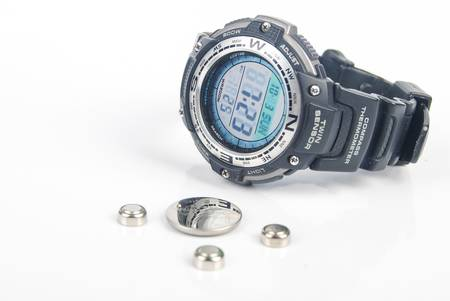lithium: Lithium battery with digital watch Editorial