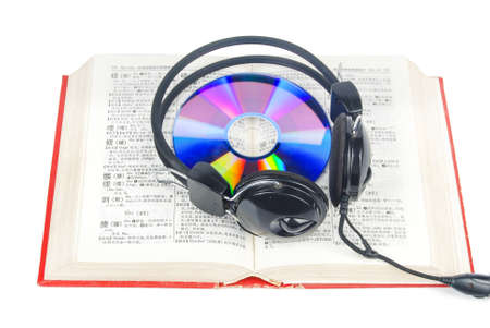 DVD,dictionary and headphone photo