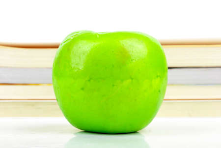 Green apple with books photo