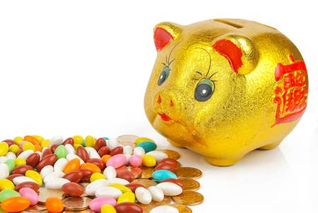 Golden piggy bank with coins Stock Photo - 13561628