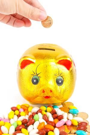 Golden piggy bank with coins photo