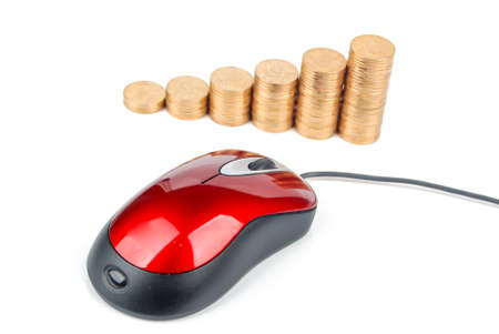 Red computer mouse and golden coins photo