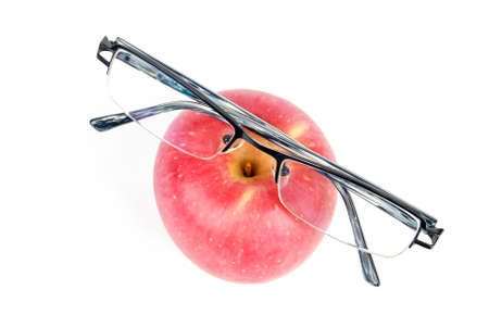 Red apple and eyeglasses photo