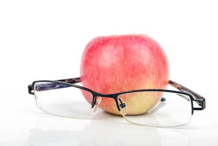 Red apple and eyeglasses Stock Photo - 13559914