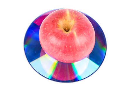 Apple with DVD on white background Stock Photo - 13560331