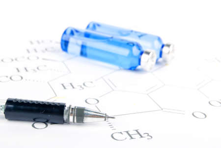 Pen and medicine on chemical formula photo