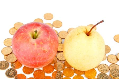Red apple and pear with coins photo
