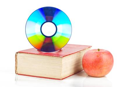 Red apple and DVD with book photo