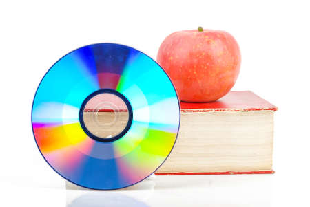 Red apple and DVD with book Stock Photo - 13581545