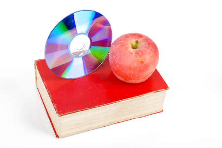 Red apple and DVD with book Stock Photo - 13581731