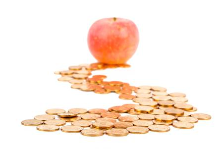 Apple with coins Stock Photo - 13580095