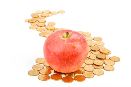 Apple with coins Stock Photo - 13581537