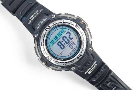 Digital watch on white background