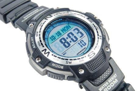 Digital watch on white background