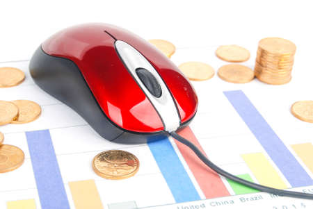 Mouse and coins on financial graph photo