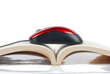 Mouse and books on white background photo