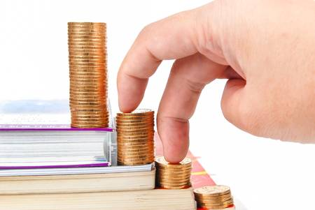 Books and coins on white background Stock Photo - 13582127