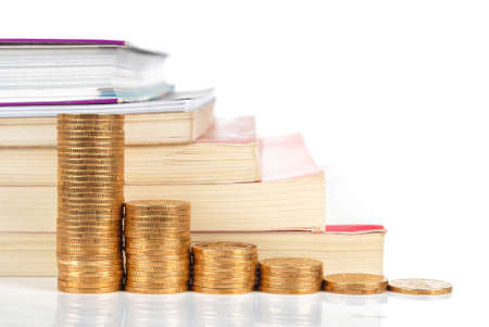 Books and coins on white background Stock Photo - 13581966