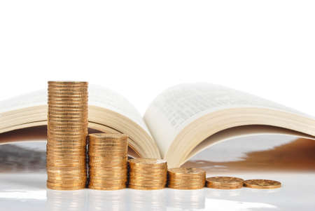 Books and coins on white background Stock Photo - 13581952