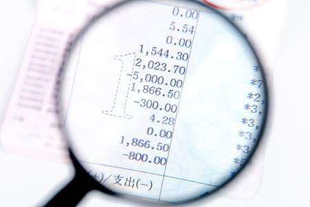 Magnifier and bankbook photo