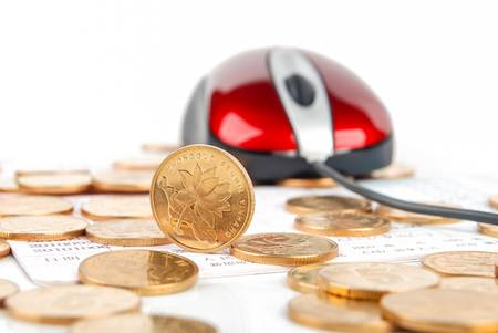 Mouse and coin on bankbook photo