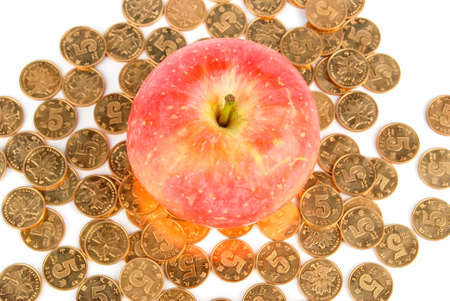 Apple and coin on white background photo
