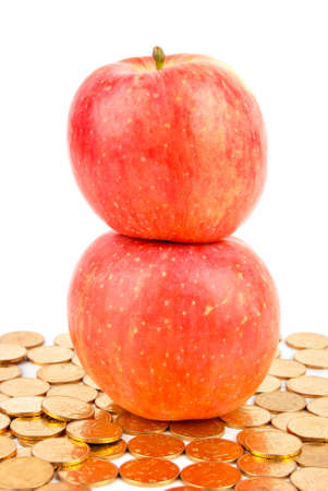 Apple and coin on white background Stock Photo - 13610142