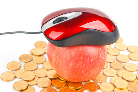 Apple and mouse with coins on white background photo