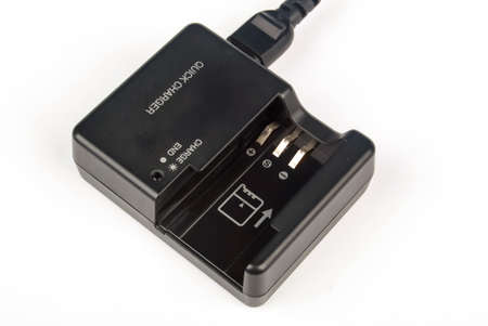 Camera battery with charger Stock Photo - 13657829