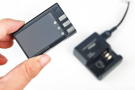Camera battery with charger photo