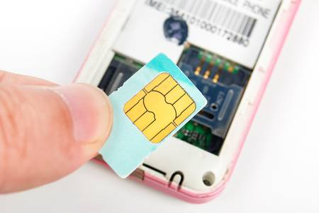 Sim card with cellphone Stock Photo - 13657921