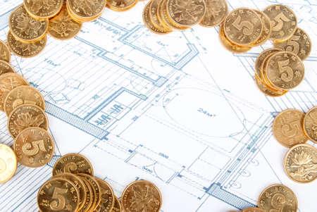 oncept: Coins on blueprint