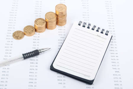 Financial data and notepad witn coin Stock Photo - 13690594