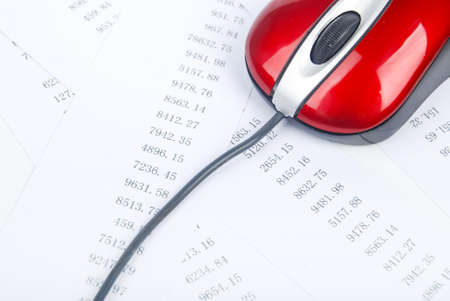 Computer mouse with financial data Stock Photo - 13690538