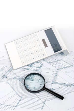 Calculator on blueprint photo