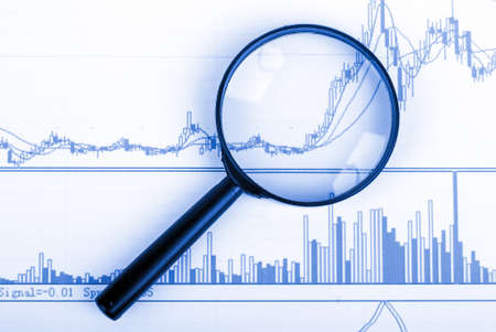 Magnifying glass and stock graph photo