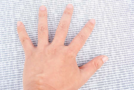 Hand on binary code Stock Photo - 13691664