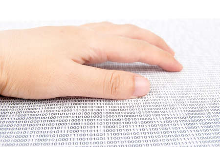 Hand on binary code photo