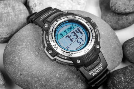 wrist strap: Electronic waterproof watch on stone