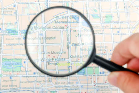 Magnifying glass with color map photo