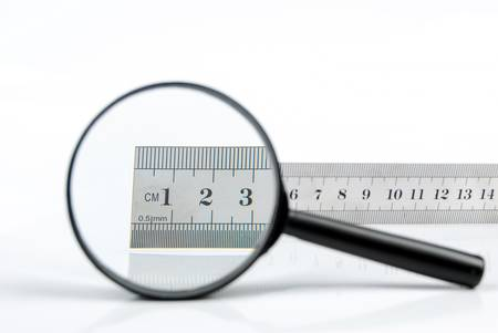 Magnifying glass with metal ruler photo