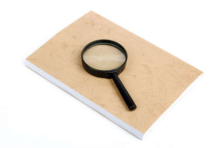 Magnifying glass focusing on book photo