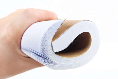Roll of book in hand Stock Photo - 13743748