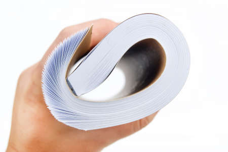 Roll of book in hand photo