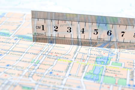 Metal ruler on map photo