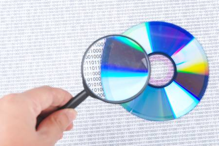 larder: Magnifying glass with DVD Stock Photo
