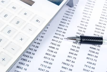 Financial statement with calculator and pen photo