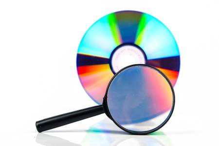 memorise: Magnifying glass with DVD Stock Photo