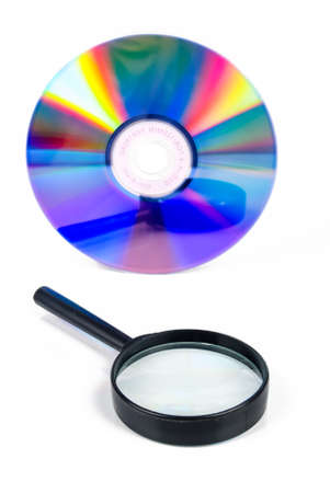 larceny: Magnifying glass with DVD Stock Photo