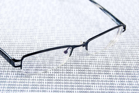Eyeglasses on binary code Stock Photo - 13752633